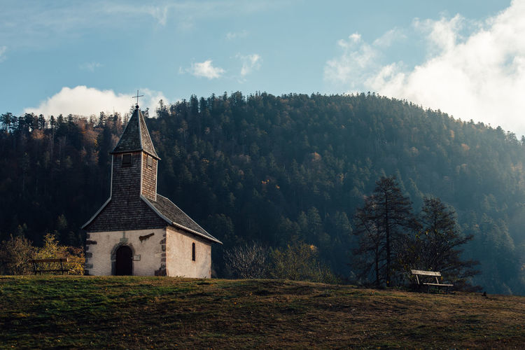 Chapel Landscape Place Of Worship Catholic Church Countryside Country Bench Tree Plant Built Structure Religion Sky Architecture Building Belief Building Exterior Land Spirituality Nature No People Field Cloud - Sky Day Outdoors Spire  Autumn Mood