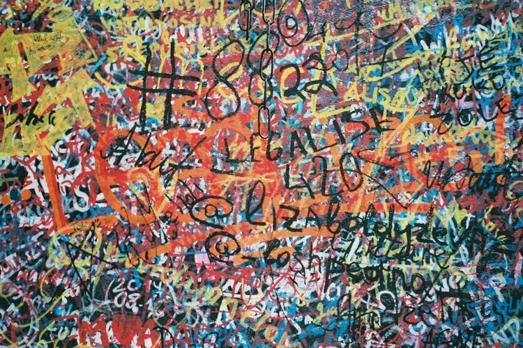 Full Frame Backgrounds Multi Colored Graffiti Text Wall - Building Feature No People Communication Street Art Creativity Day Built Structure Western Script Outdoors Architecture Wall Close-up Messy Art And Craft Pattern