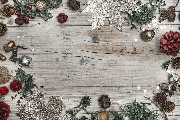 autumnal gray wood background with decoration Celebration Christmas Christmas Decoration Christmas Ornament christmas tree Decoration Directly Above Food Food And Drink Freshness Fruit Holiday Indoors  Nature No People Pine Cone Plant Table Tree Wood - Material