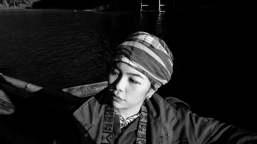 Close-up of thoughtful woman in boat on lake