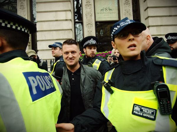 Tommy Robinson. Founder of the English Defence League, goading anti Facism protesters and being escorted away by Metropolitan police officers. London. 01-04-2017 Tommy Robinson English Defence League Metropolitan Police Olympus Stevesevilempire London News Policing Police Force Steve Merrick EDL Zuiko London Right Wing Racism Police Racist