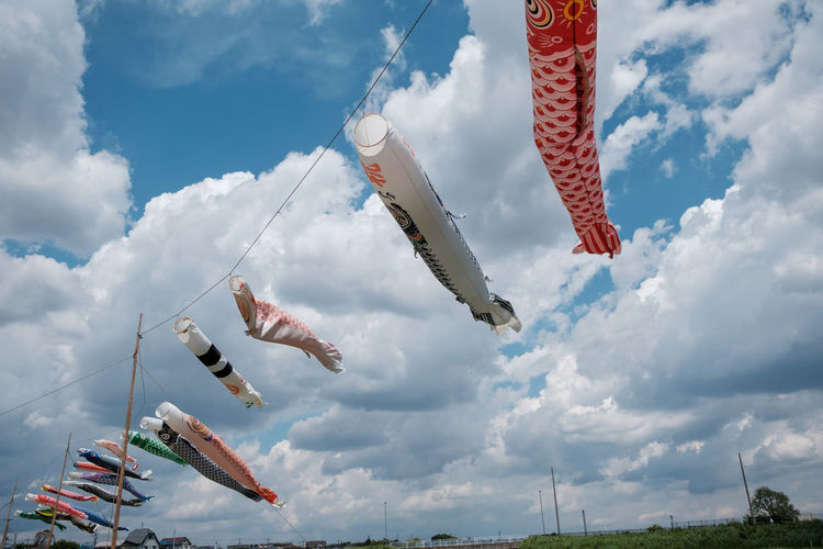 Low angle view of fish hanging against sky