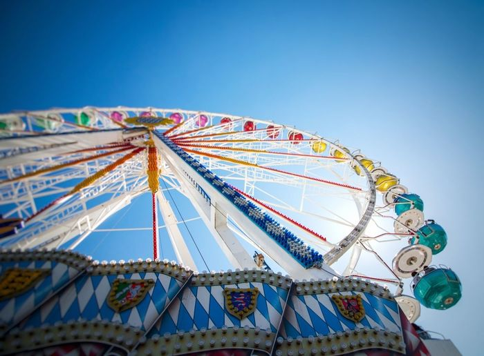 Amusement Park Ferris Wheel Traveling Carnival Arts Culture And Entertainment Clear Sky Blue Sky Rollercoaster First Eyeem Photo