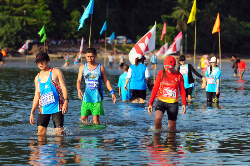 Asian Culture Athlete Beach Chumphon Cross Sea Running Day Funrun Langsuan Traditional Long Boat Racing Festival, Thailand Marathon Runner Ocean Outdoors People Physical Activity Pithak Island Pithak Island Runner Running Sea Sky Sport Street Thai Water Women วิ่งแหวกทะเลสู่เกาะพิทักษ์