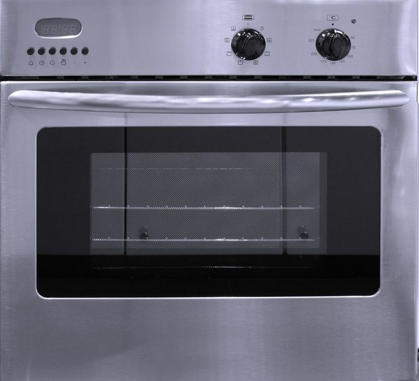 A modern stove made from stainless steel with oven compartment Household Equipment Equipment Kitchen Appliance Stove Oven Kitchen Stove Stainless Steel  Modern Equipment Dials Thermostat Cooking Device Cooking Baking