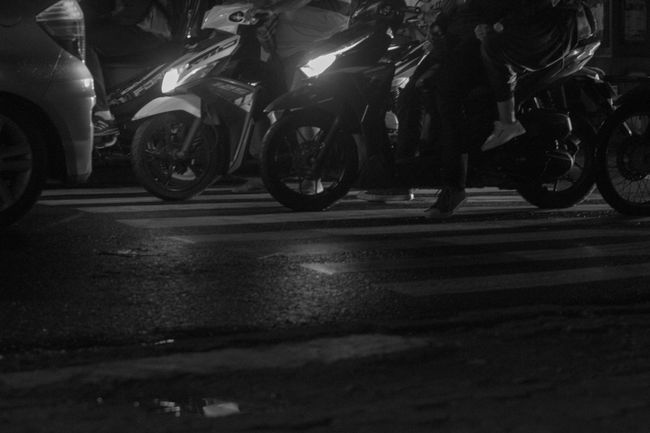 Motor Cross Transportation Land Vehicle Road Mode Of Transport Outdoors Close-up Old Transportation Night Illuminated Semarang Blackandwhite Monochrome Journalism Indonesia_photography Indonesia Street Photography Streetphotography Streetphoto_bw Leisure Activity City Life Real People Lifestyles Street Shadow Low Section