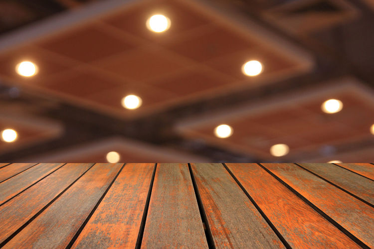 Wooden table and blurred image of motor show,show room,motor expo for background Abstract; Acceleration; Aerial; Auto; Automobile; Automotive; Background; Benz; Blur; Blurred; Bokeh; Business; Car; Color; Concept; Cooper; Crowd; Defocused; Depth; Distribution; Dream; Drive; Exhibition; Exterior; Inside; Interior; Lifestyle; Light; Min Close-up Illuminated Indoors  Night No People Wood - Material