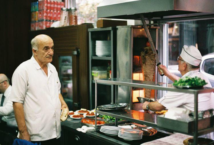 Man preparing food in kitchen