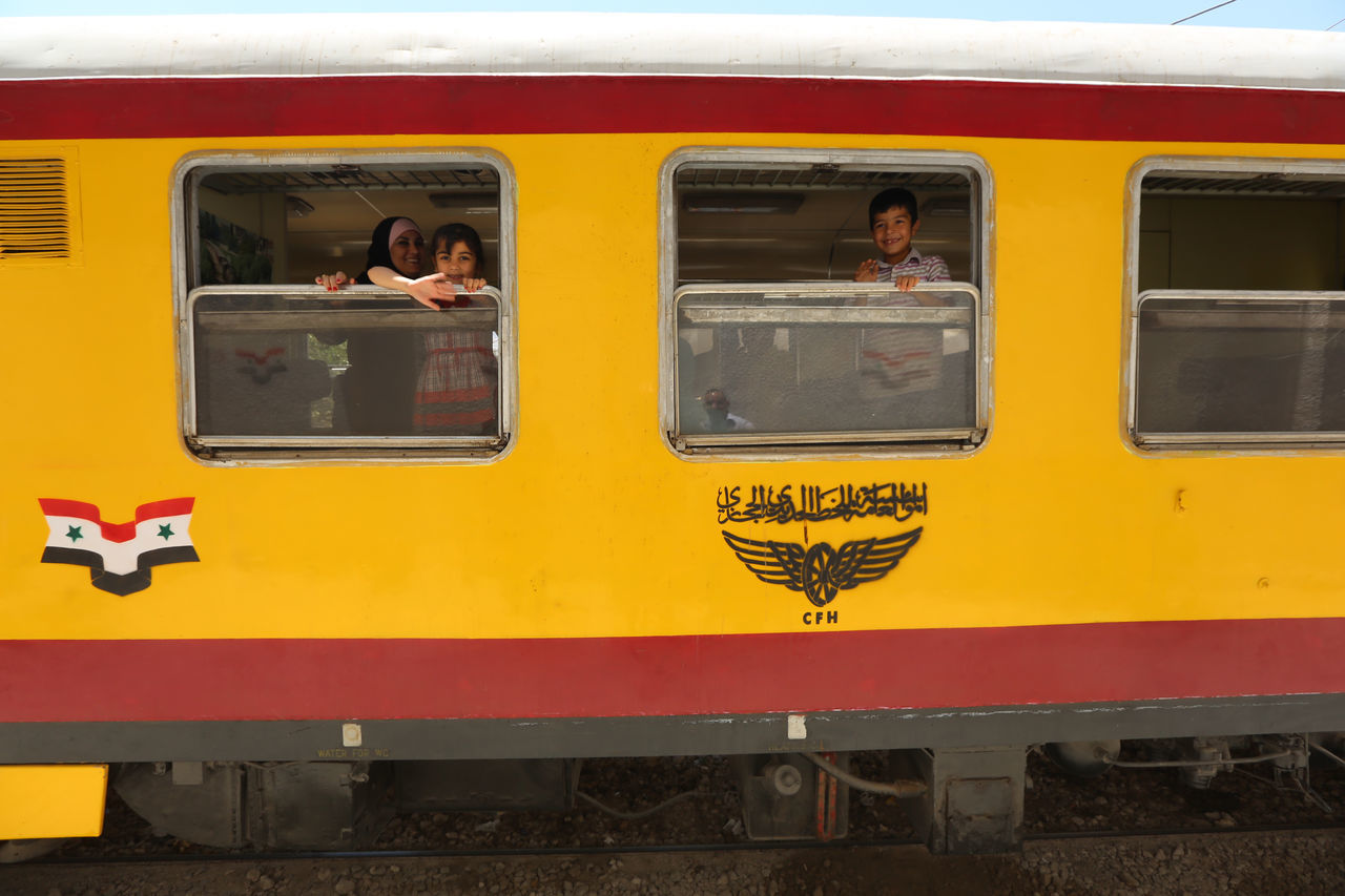 yellow, mode of transport, transportation, public transportation, window, land vehicle, train - vehicle, day, outdoors, real people