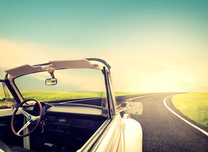 Vintage Journeys with classic car concept of love in summer and wedding honeymoon Transportation Mode Of Transportation Sky Car Road Motor Vehicle Sunset Nature Sunlight Day Travel Driving Street Landscape Retro Styled Outdoors Road Trip