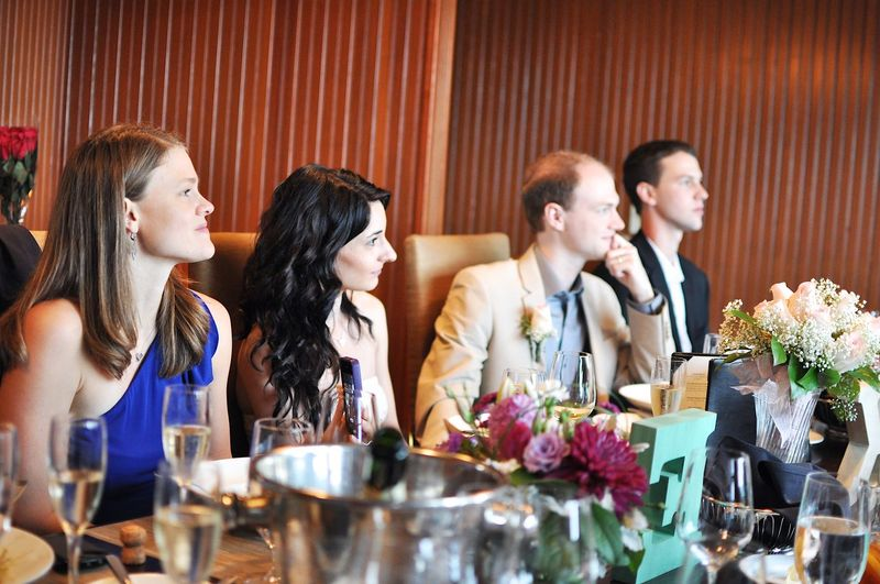 People sitting at table during wedding