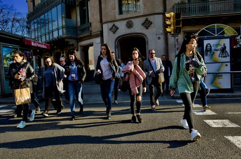Building Exterior City Group Of People Architecture Street Real People Full Length Built Structure Men Women Large Group Of People Shadow Adult Sunlight Lifestyles Crowd Casual Clothing City Life Walking Teenager Barcelona