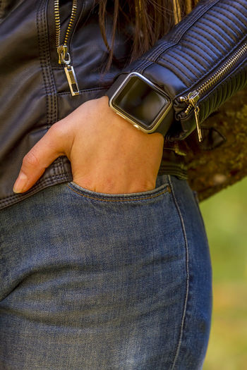 Midsection Of Woman Wearing Smart Watch