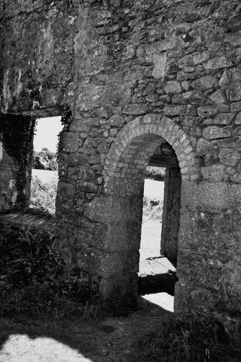 Architecture Built Structure Day No People History Outdoors Nature Old Ruin Ancient Architecture Rural Scene Cornwall Cornishmine Cornwall Uk Blackandwhite Black & White Blackandwhite Photography Cornish Tin Mine The Past Building Exterior Grass Arch