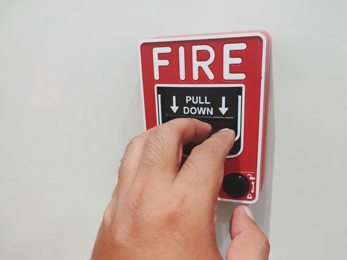 The male hand is pushing the fire alarm. Red Nail Polish Pink Nail Polish Toenail Pedicure Fire Engine Extinguishing Firefighter Nail Art Manicure Nail Polish Nail File Fire Hose Painting Fingernails Do Not Enter Sign Fingernail Hand Fire Extinguisher Emergency Equipment Stop Sign Stop - Single Word Finger Fire Alarm Close-up Authority Human Finger Studio Shot Red Computer Crime White Background Human Hand Human Body Part Text One Person Communication Western Script Holding Real People Indoors  Body Part Personal Perspective Technology Unrecognizable Person Number