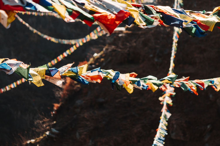 Close-up of multi colored flags hanging outside temple