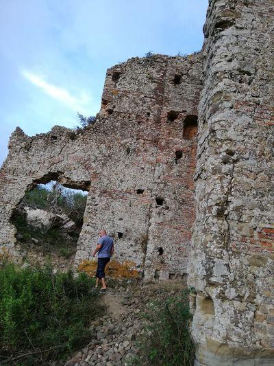 Full length of man walking against old ruins