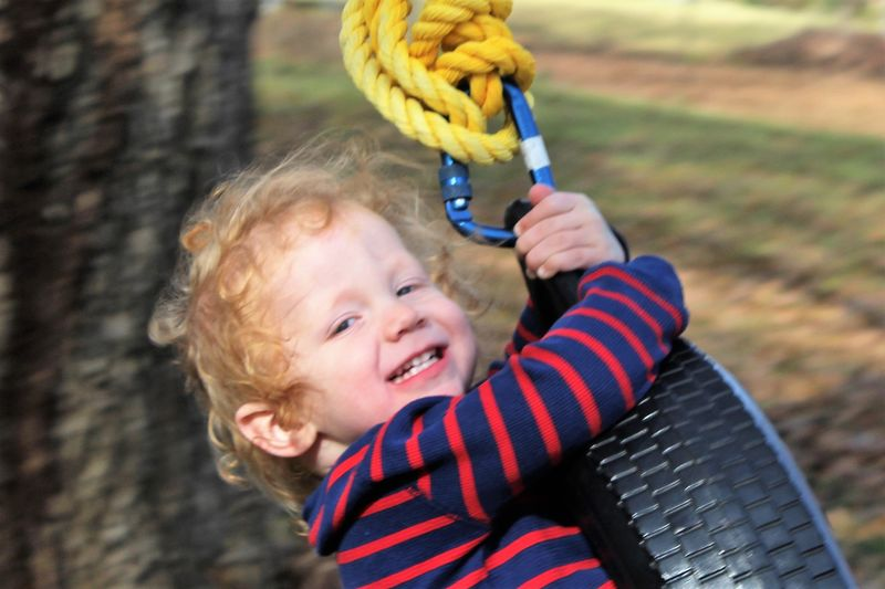 Tire Swinging Boy! Childhood Child One Person Portrait Smiling Holding Headshot Focus On Foreground Day Innocence Happiness Hair Cute Real People Outdoors