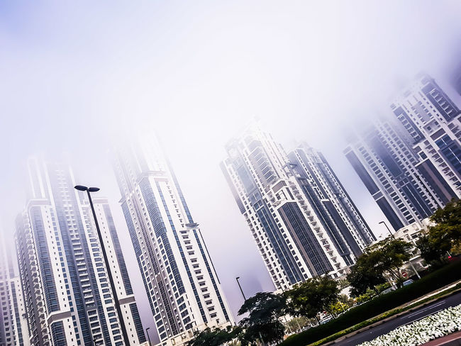 Fog City Building Exterior Architecture Low Angle View Skyscraper Built Structure Adapted To The City Downtown District Urban Skyline Sky Cityscape Outdoors No People Day Bay Avenue Dubai Blue Cloud - Sky Travel Destinations UAE UAE , Dubai Architecture Downtown Dubai Dubai Streetphotography