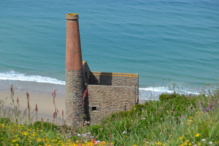 Water Sea Nature Beach Grass Outdoors Wave Tranquility Beauty In Nature Land Day High Angle View No People Plant Wood - Material Tranquil Scene Growth Scenics - Nature Motion Wooden Post St Agnes Cornwall Uk Tinmine Ruins