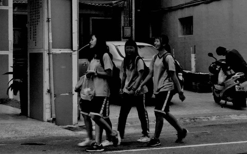 Street photography series: Students are off from the school Students In Asia Street Photography Real People Group Of People Architecture Men Building Exterior City Built Structure Full Length Lifestyles Street Walking Day People Women Medium Group Of People Outdoors Group Clothing