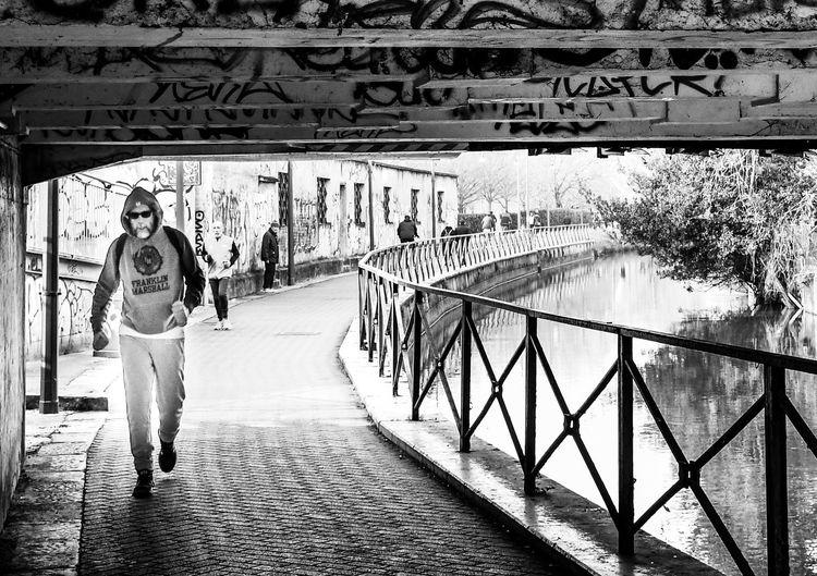 Full length portrait of man standing on footbridge