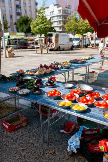 Various fruits on street against buildings in city