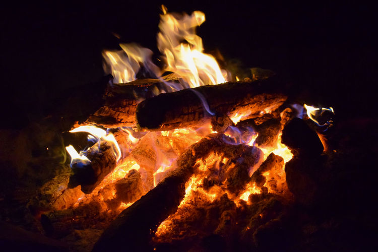 Campfire. Campfire EyeEm Best Shots Nightphotography Blurred Motion Bonfire Burning Campfire Close-up Fire Fire - Natural Phenomenon Firewood Flame Glowing Heat - Temperature Log Motion Nature Night No People Orange Color Outdoors Wood Wood - Material Yellow Camp