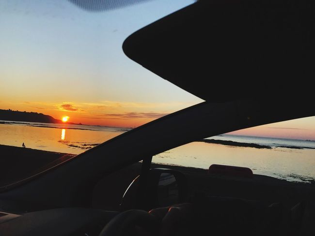 Sunset in Guernsey. Sunset Sky Nature Beauty In Nature Capture The Moment The Here And Now IPhone Photography Clouds Water Sea And Sky Taken From A Moving Vehicle Windscreen Steering Wheel Coastline Rocks Neighborhood Map EyeEm Best Shots