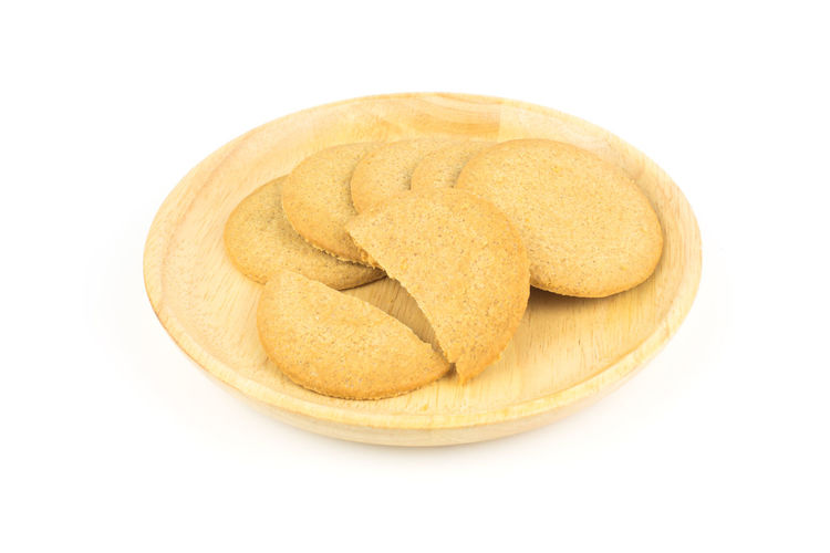 Close-up of bread over white background