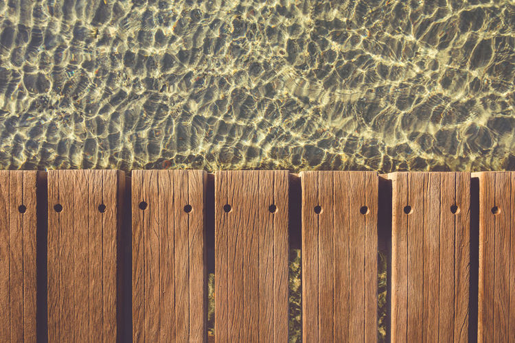 Wood texture deck versus warm late October sea water. Shot this one a few hours ago, while cycling along the peninsula of Giens, Hyeres. Autumn Colors In South Of France Backgrounds Beach Beach Theme Contrast Colors Deck France 🇫🇷 French Riviera Full Frame Hard Contrast In A Row Old Film Look Old School Like Outdoors Sunlight Water Wood - Material Wood Deck Wood Detail Wood Texture Look Down Light And Shadow Dock