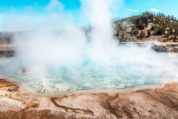 Steam rising from the turquoise pool, yellowstone national park