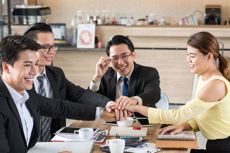 Agreement Business Business Person Businessman Businesswoman Cheerful Colleague Communication Cooperation Corporate Business Coworker Customer  Discussion Handshake Happiness Indoors  Meeting Men Mid Adult Men Smiling Suit Teamwork Togetherness Women Working