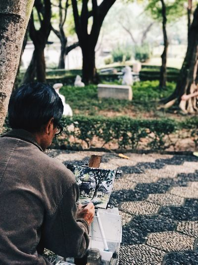 The Street Photographer - 2017 EyeEm Awards Real People Technology Men Tree One Person Working Day Sitting Wireless Technology Outdoors One Man Only Nature Only Men Adult People Adults Only