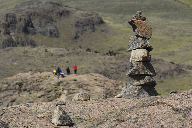 Rock Solid Rock - Object Nature Day Group Of People Mountain Stack Environment Landscape Focus On Foreground Incidental People Outdoors People Activity Leisure Activity Rock Formation Adventure Balance Trekking