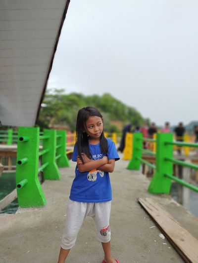 Portrait of smiling girl standing outdoors