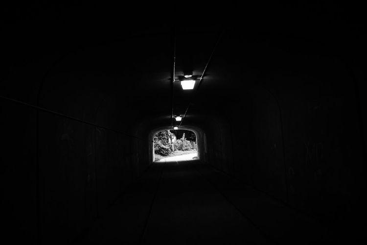 Empty corridor in illuminated building