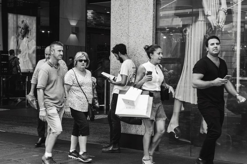 Live For The Story Full Length Shopping Bag Casual Clothing Women Lifestyles Leisure Activity Men Retail  Young Women Young Adult Building Exterior Standing Outdoors Real People Looking At Camera Smiling Day Adult Friendship