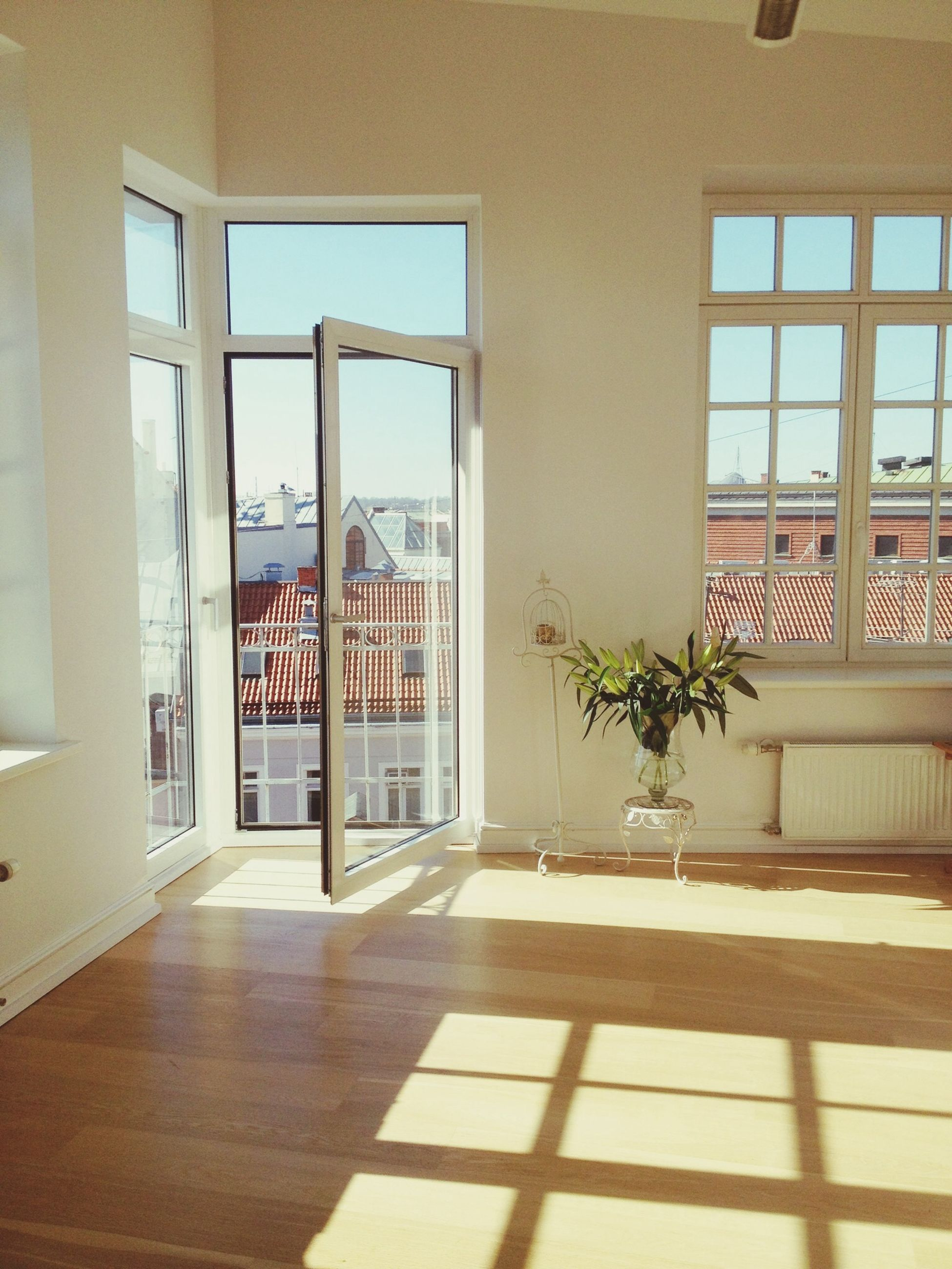 indoors, window, architecture, built structure, glass - material, potted plant, house, flooring, home interior, door, tiled floor, empty, absence, transparent, sunlight, no people, table, day, plant, residential structure