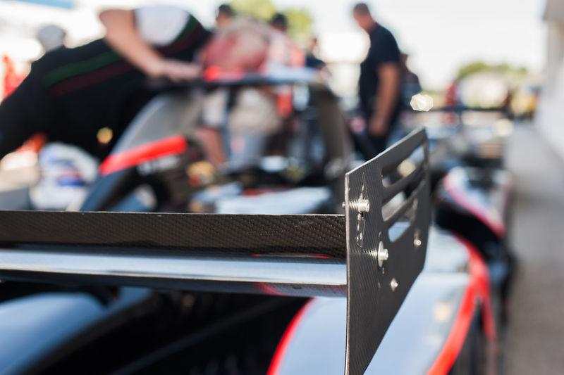 Close-up of racecar spoiler at starting line