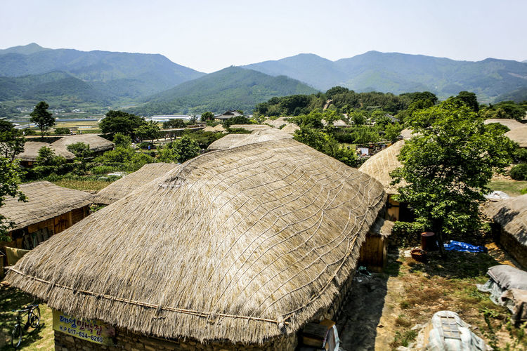 Ancient Civilization Community Culture Day Grass Green Green Color Hill Human Settlement Hut Landscape Lush Foliage Mountain Non-urban Scene Old Old House Outdoors Suncheon Thatched Cottage Thatched Roof Thatchedroof Tranquil Scene Tranquility Vacation Village