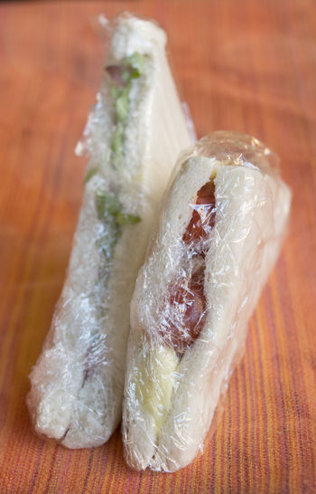 stuffed sandwiches wrapped in transparent film Bar Fast Food Fastfood Filled Film Packaged Pub Sandwich Sandwiches Snack Stuffed Tramezzini Transparent