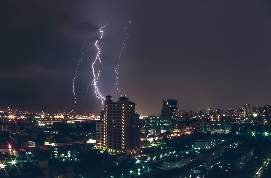 Thunderstorm Lightning Night Architecture City Storm Cityscape Weather Danger Environment Dramatic Sky Power In Nature Electricity  Light - Natural Phenomenon Storm Cloud Skyscraper City Life Thailand Bangkok Bangkok Thailand. ASIA Nightphotography