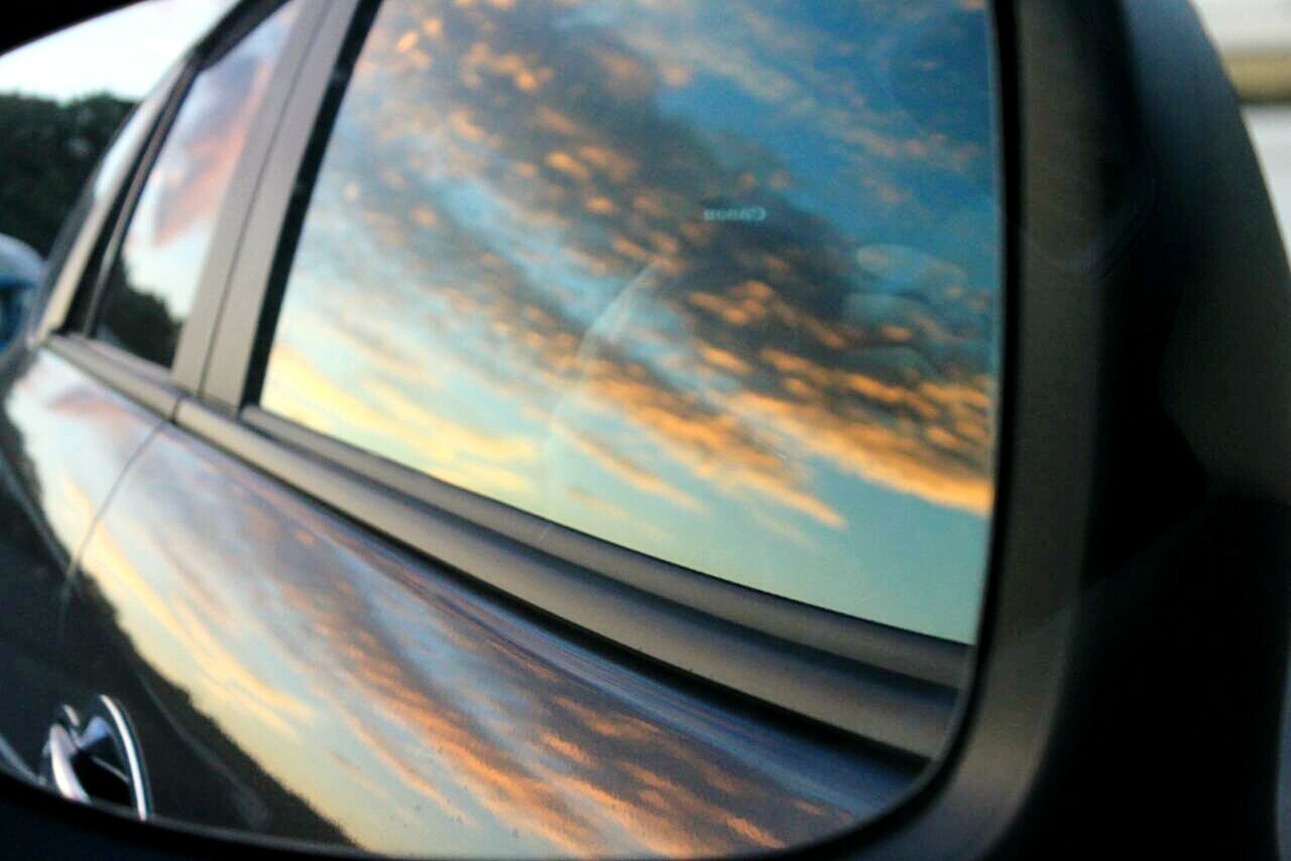 transportation, mode of transport, vehicle interior, car, land vehicle, glass - material, transparent, window, car interior, part of, travel, windshield, side-view mirror, on the move, reflection, cropped, airplane, journey, vehicle part, sky