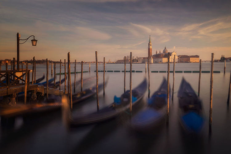 Venice Water Building Exterior Nautical Vessel Gondola - Traditional Boat Architecture Mode Of Transportation Travel Destinations No People Wooden Post Canal Moored Transportation Sunset Sky Post Cloud - Sky Travel Italy Venice, Italy