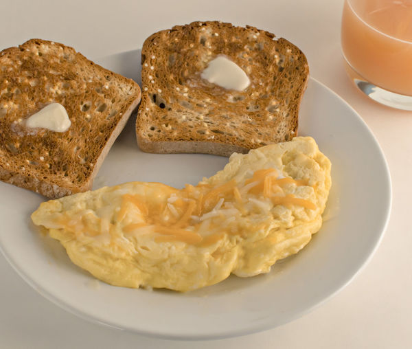 Melting Cheese Bread Breakfast Cheese Cheese Omlet Close-up Eggs Eggs For Breakfast Food Food And Drink Freshness Melting Butter Omlet Omlette Orange Juice  Orange Juice In Glass Plate Ready-to-eat Toasted Bread Toasted Bread With Honey