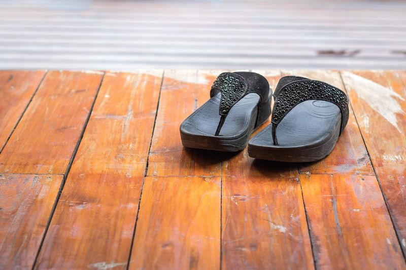 Close-up of flip-flop on table