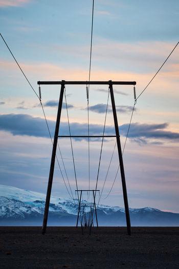 Sky Cloud - Sky Scenics - Nature Sunset Sea Water Beauty In Nature No People Tranquil Scene Nature Tranquility Cable Land Horizon Outdoors Non-urban Scene Beach Horizon Over Water Connection Powerlines Infrastructure Electricity  Symmetry Iceland Vertical Composition