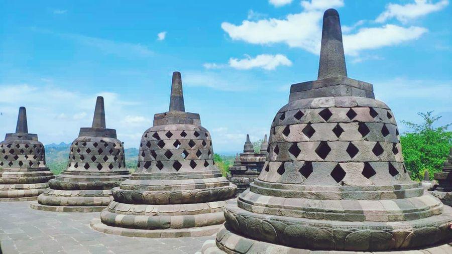 Stupas of temple building against sky