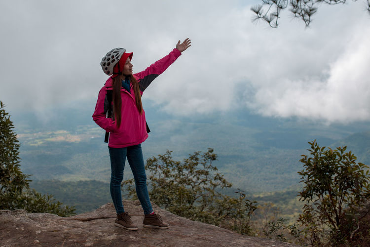 Woman enjoying with nature in the National Park One Person Standing Full Length Nature Casual Clothing Red Leisure Activity Sky Day Clothing Plant Non-urban Scene Beauty In Nature Women Tree Lifestyles Scenics - Nature Looking Human Arm Outdoors Happiness Woman Travel Tourism Foggy